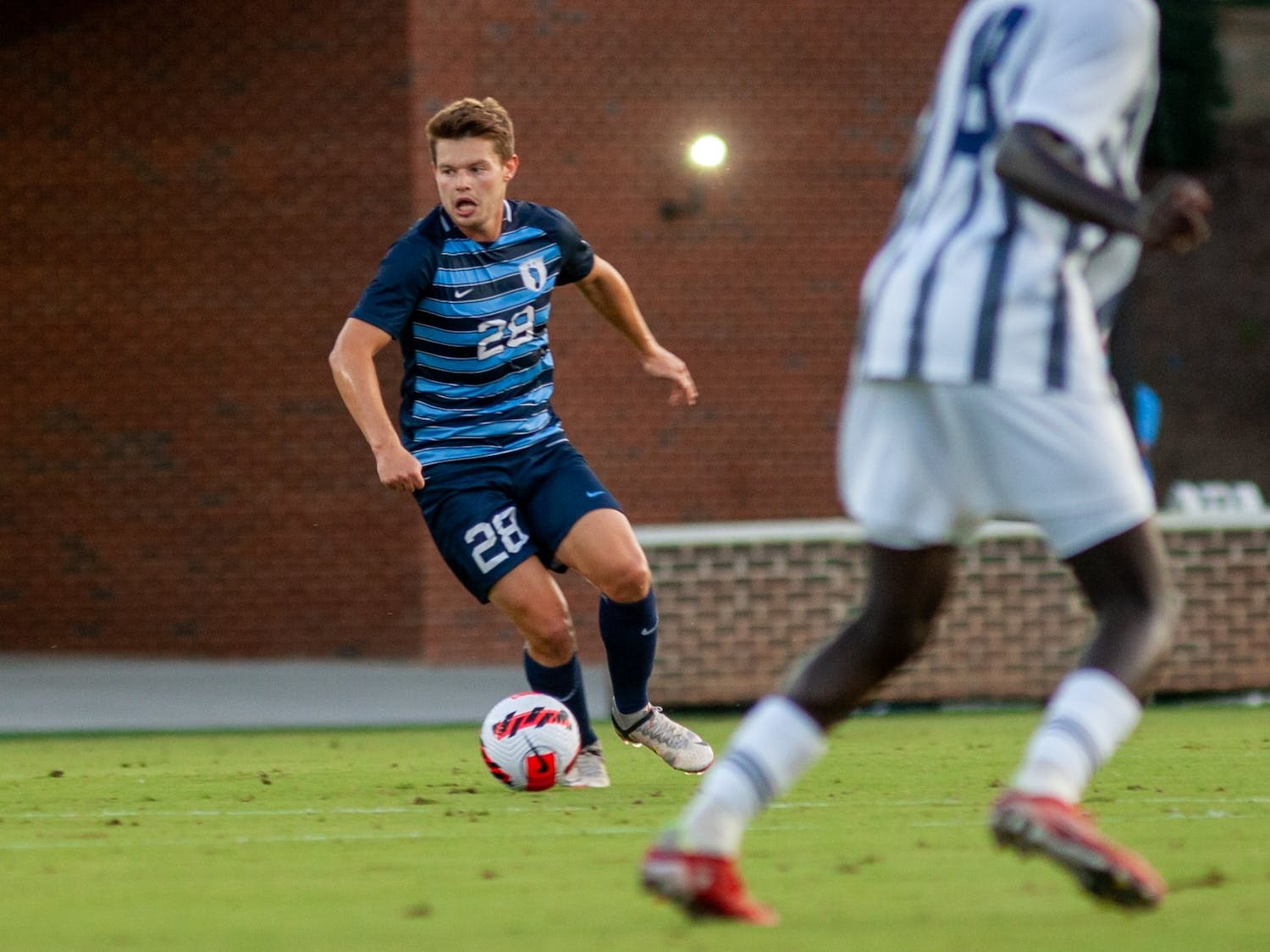 UNC sophomore midfielder Tim Schels (28) maintains posession of the ball at the UNC v. Georgia Southern game at Dorrance Field on Sept. 3.