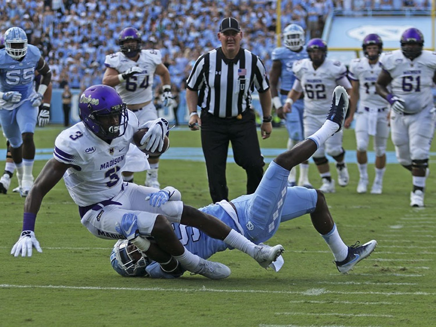 UNC cornerback Patrice Rene (5) tackles James Madison's Domo Taylor (3) on Saturday.