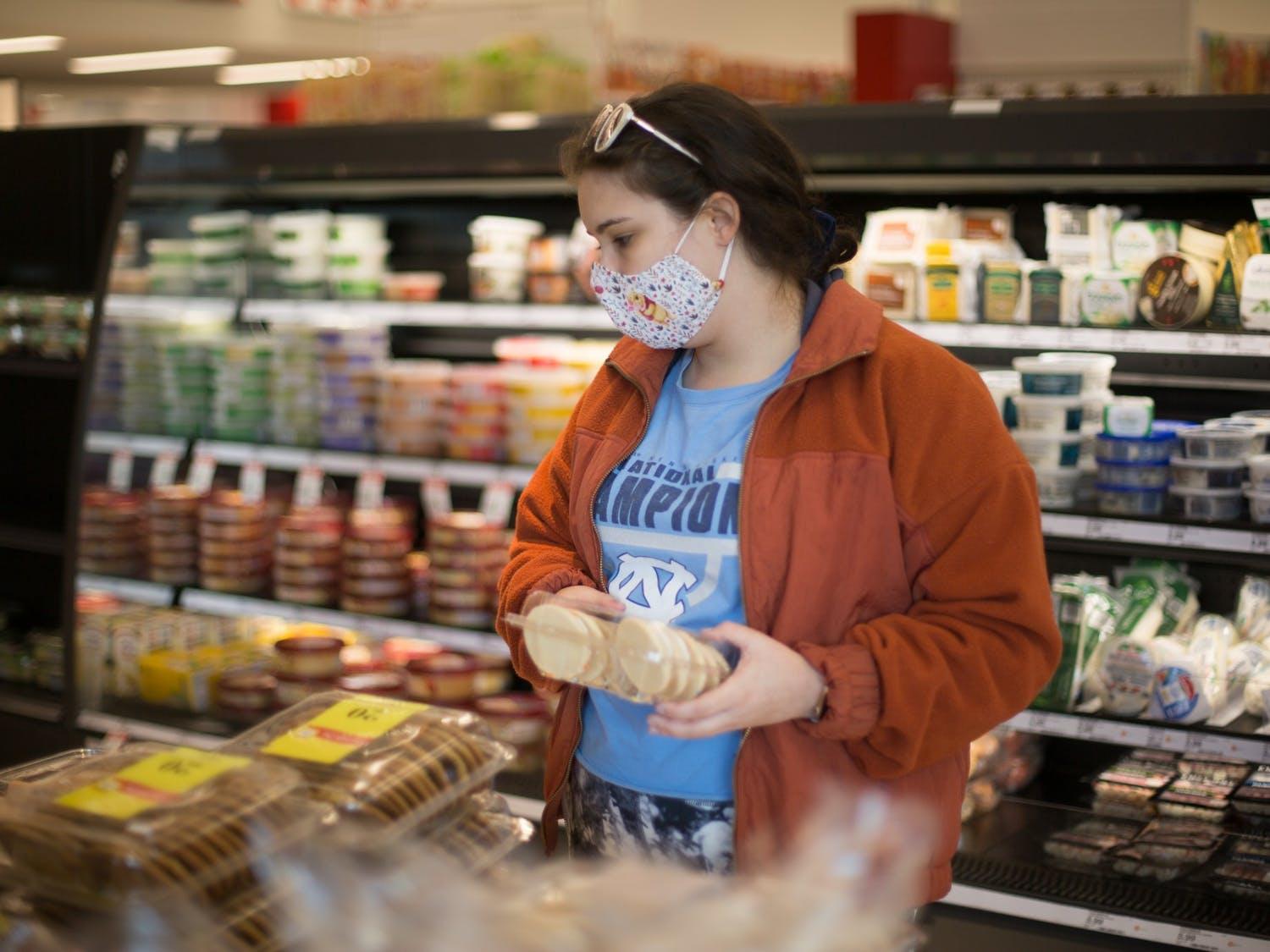 Madison Bennett, a 24-year-old Chapel Hill resident, shops for food at the Target on Franklin Street on Friday, March 19, 2021.