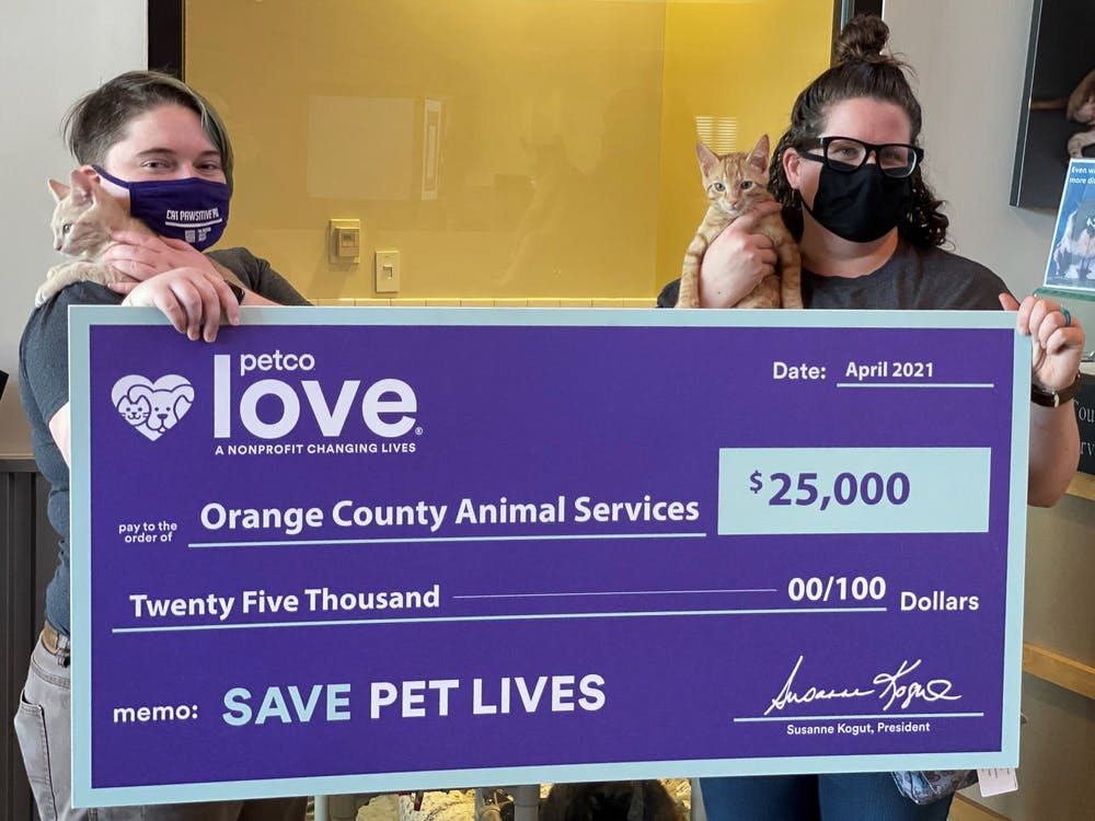 <p>Scarlett Lucas and Tiani Schifano are employees at the Orange County Animal Shelter. Orange County Animal Services recently received a $25,000 grant from PetCo. Photo courtesy of Orange County Animal Services</p>