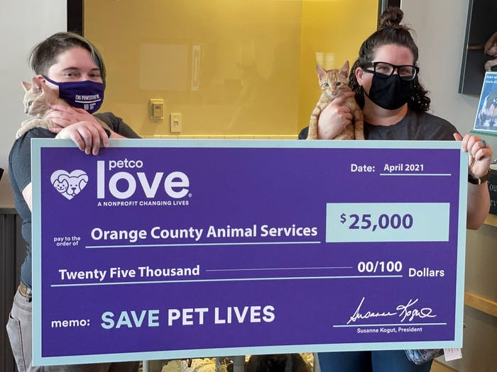 Scarlett Lucas and Tiani Schifano are employees at the Orange County Animal Shelter. Orange County Animal Services recently received a $25,000 grant from PetCo. Photo courtesy of Orange County Animal Services