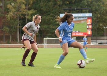 Sophomore forward Rachel Jones (10) creates space between herself and her defender in the game against Virginia Tech on Sunday, Oct. 27, 2019. UNC beat Virginia Tech 2-0.