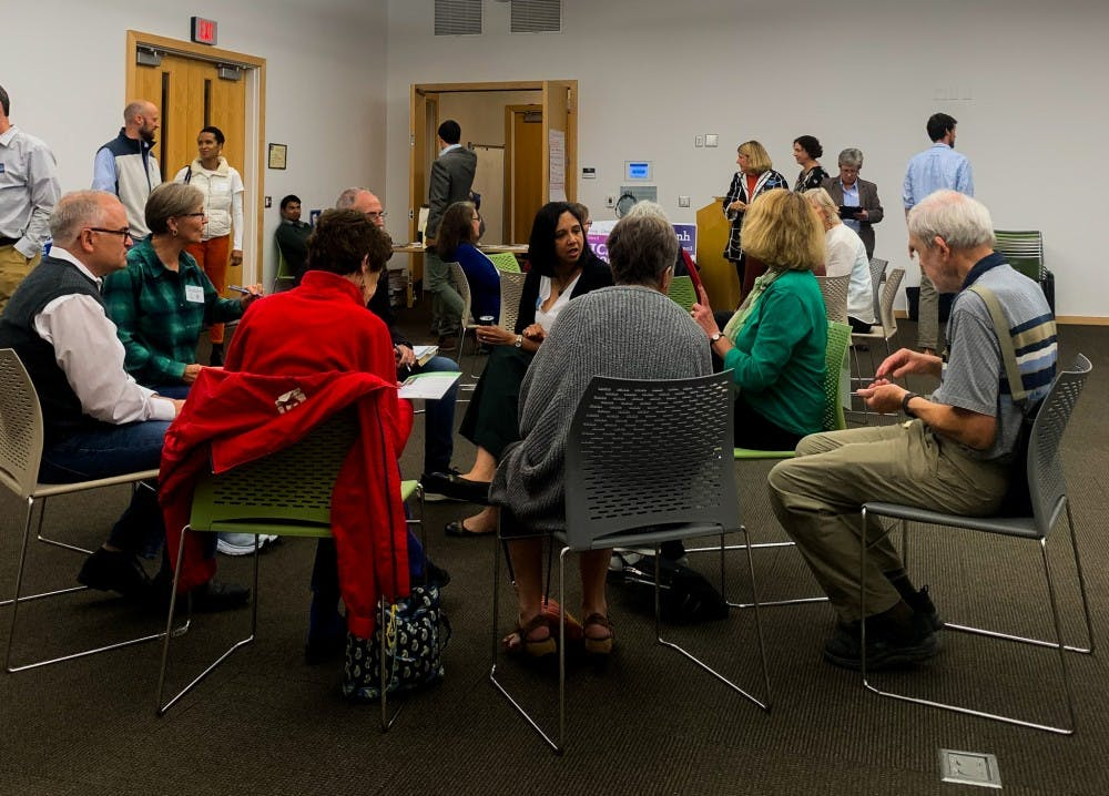 Candidates swarm voters with policy objectives at 'speed dating' event