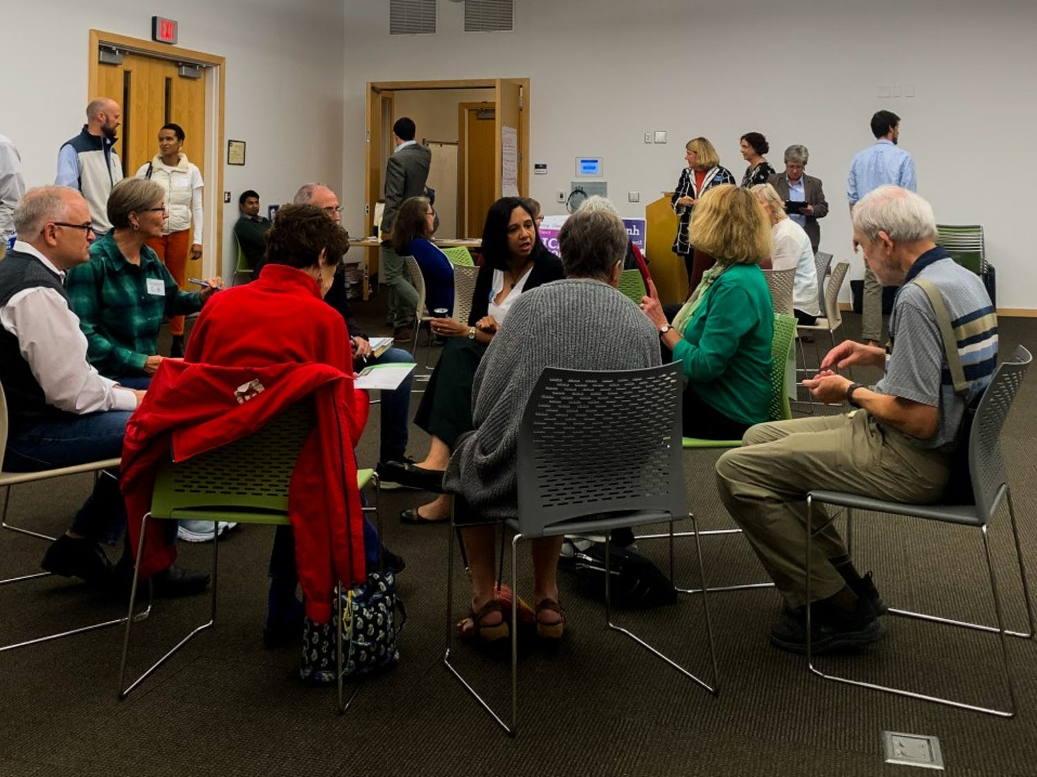Candidates and participants discuss their plans in small group discussions at the Chapel Hill Public Library on Wednesday, October 23.