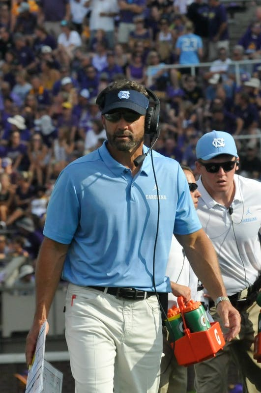 Larry Fedora walks down the field during UNC-ECU football game on Sept. 8th at Dowdy-Ficklen Stadium that resulted in a loss of 19-41.