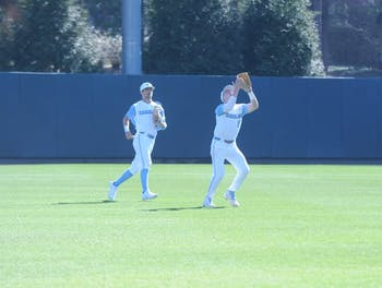 Ike Freeman (8) makes the game-ending catch during the first game of Saturday's double header against UMass Lowell. UNC beat UMass Lowell 5-0 during the first game on Saturday, March 2, 2019.