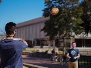 Eli Grossman, junior Business Administration and History major, plays football on the quad with sophomore Economics major Luke Hines.
