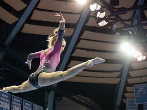 First-year Elizabeth Culton performs her bar routine during the gymnastics meet against the University of New Hampshire in Carmichael Arena on Monday, Feb. 17, 2020. The Tar Heels placed first against the Wildcats.