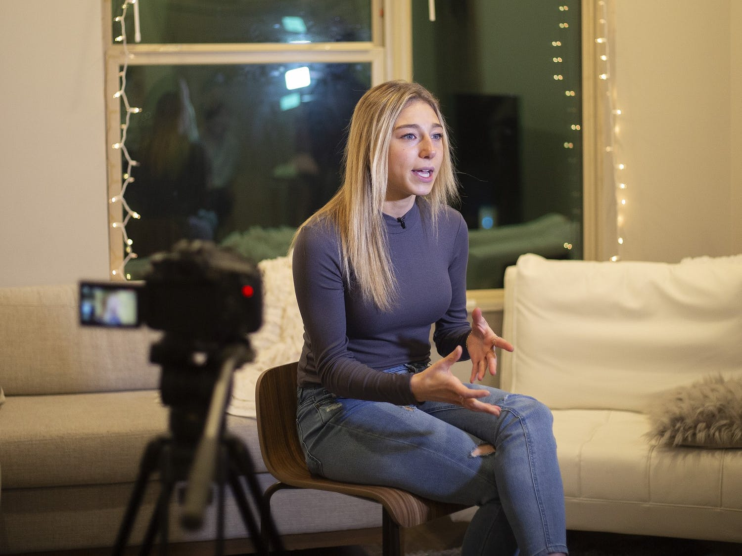 """Alexa Casciano sits in her friend's living room on February 2, 2021. Casciano was in the hospital for 28 days when she was sixteen. The experience changed her outlook on life. Casciano said, """"You know there are not a lot of things you can control in your life, but the way you feel is definitely one of them. If you are going through hell, keep going. I think about that every single day."""" Photo courtesy of Dana Gentry."""
