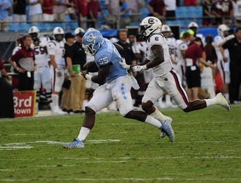 After intercepting a throw senior defensive lineman Jason Strowbridge (55) runs across the field for a touchdown with seconds left in the game during the Belk College Kick Off in Charlotte, NC on Saturday, August 31, 2019. UNC beat the University of South Carolina 24-20.