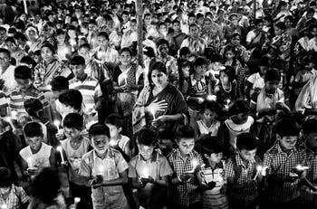 """""""Villagers observe a candlelight vigil in memory of the Hiroshima victims on Hiroshima Day"""" is one of the photographs that can be seen in """"Nuclear Visions"""" at Hanes Art Center. Photo courtesy of Amirtharaj Stephen."""