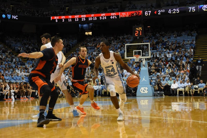 Guard Kenny Williams (24) drives against Bucknell on Nov. 15 in the Smith Center.