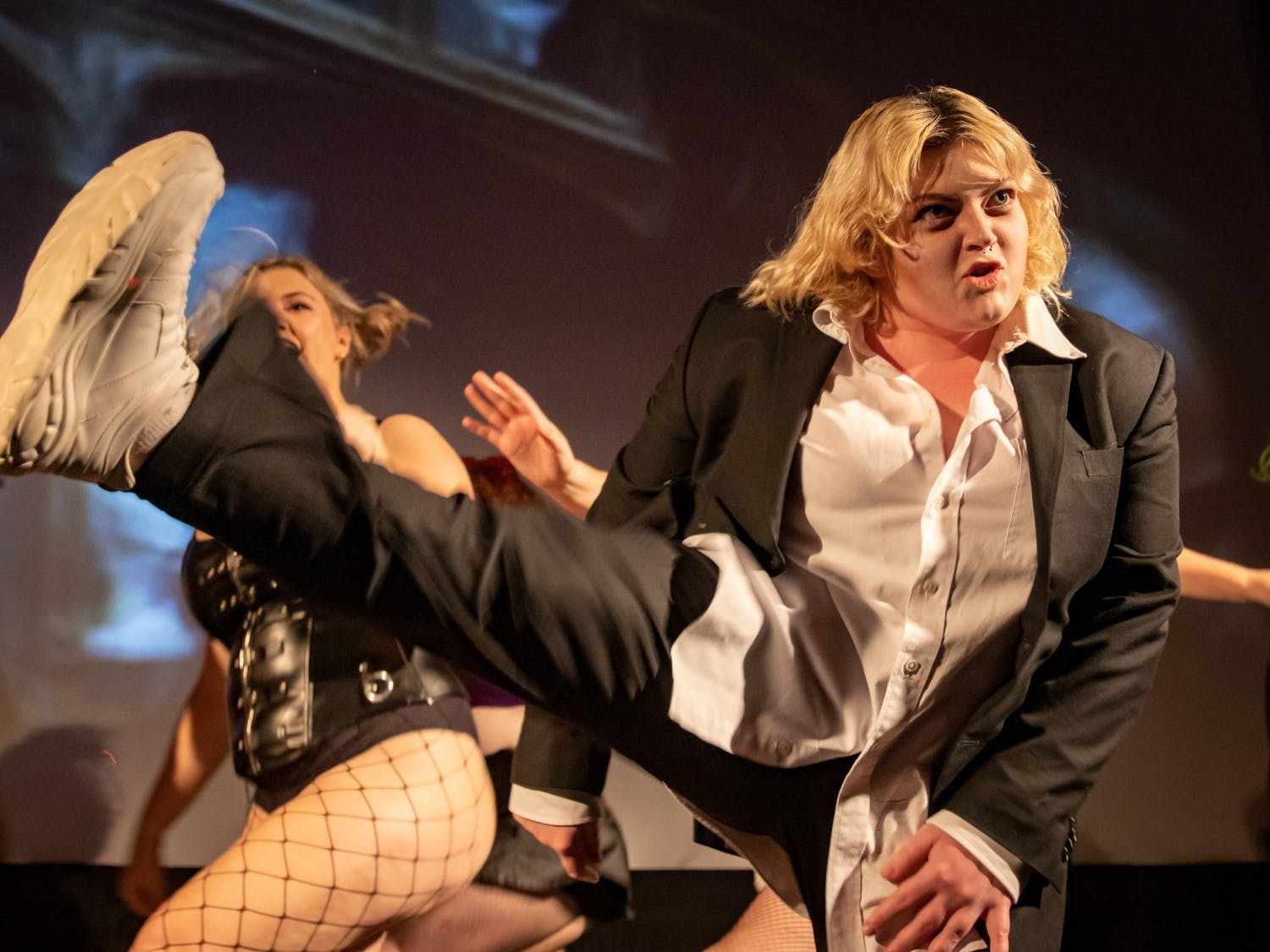 UNC junior Lily Vance portrays Riff during an Oct. 26 technical rehearsal of the Rocky Horror Picture Show at the Varsity Theatre. The production is an annual tradition of the UNC Pauper Players.