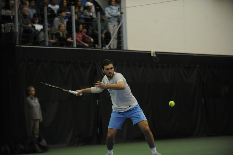 Junior William Blumberg, undeclared major, playing for the UNC men's tennis team against Duke on Jan. 26, 2019, in the Cone-Kenfield Tennis Center. UNC won 4-1 against Duke.