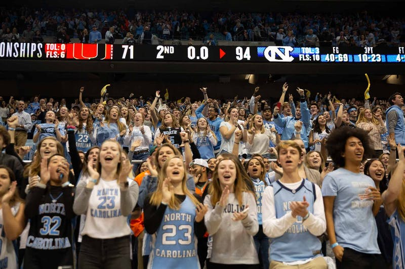UNC fans celebrate the win against Miami after the game at the Deam Smith Center on Saturday, Jan. 25, 2019. UNC defeated Miami 94-71.