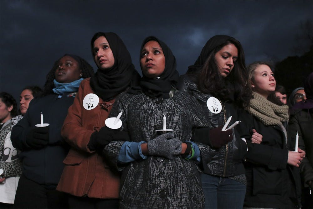 Hundreds of mourners came to the Three Winners vigil to commemorate the one year anniversary of the Chapel Hill shootings on Wednesday.