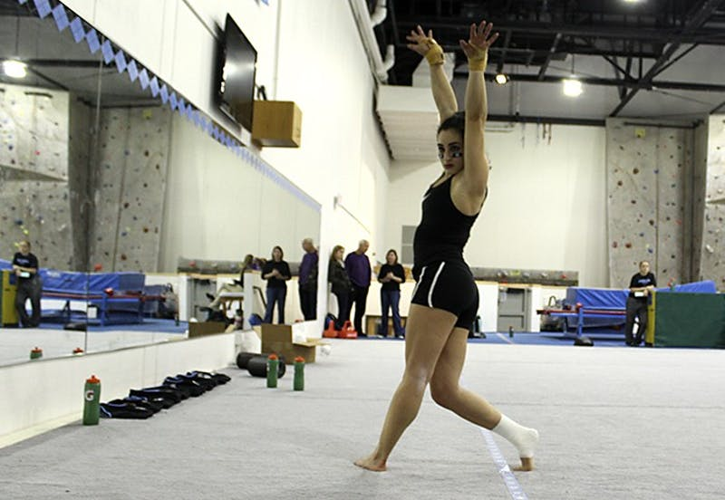 Lexi Cappalli poses during her floor routine during Thursday afternoon's practice at Fetzer gym.