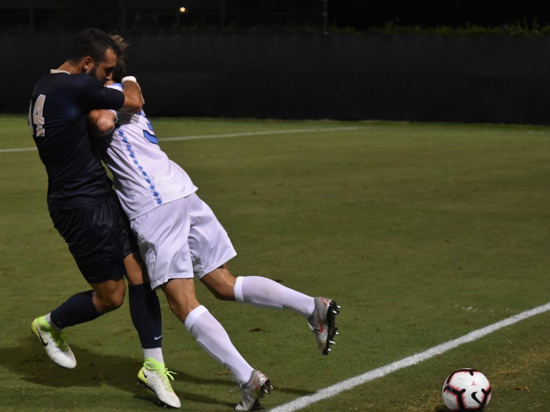 Midfielder Milo Garvanian (32) fights for the ball against defender Jose Luis Sena Arbona (14) during Saturday night's game against Pittsburgh at Koskinen Stadium.