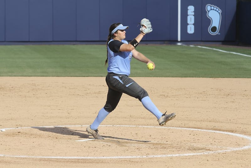 Freshman Brittany Pickett(28) pitches on Wednesday during the game against James Madison University.