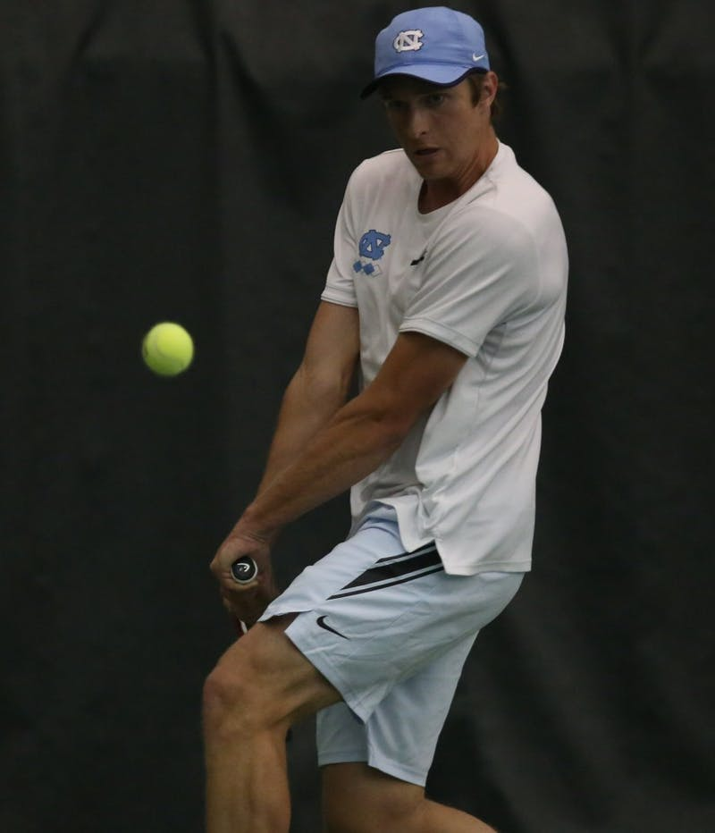 UNC men's tennis first-year Brian Cernoch returns the ball during a doubles match against Boston College on Friday April 5, 2019. UNC defeated Boston College 5-1.