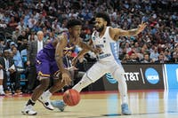 Joel Berry II (2) pressures Lipscomb's Kenny Cooper (21) during a first-round NCAA Tournament game in Charlotte.