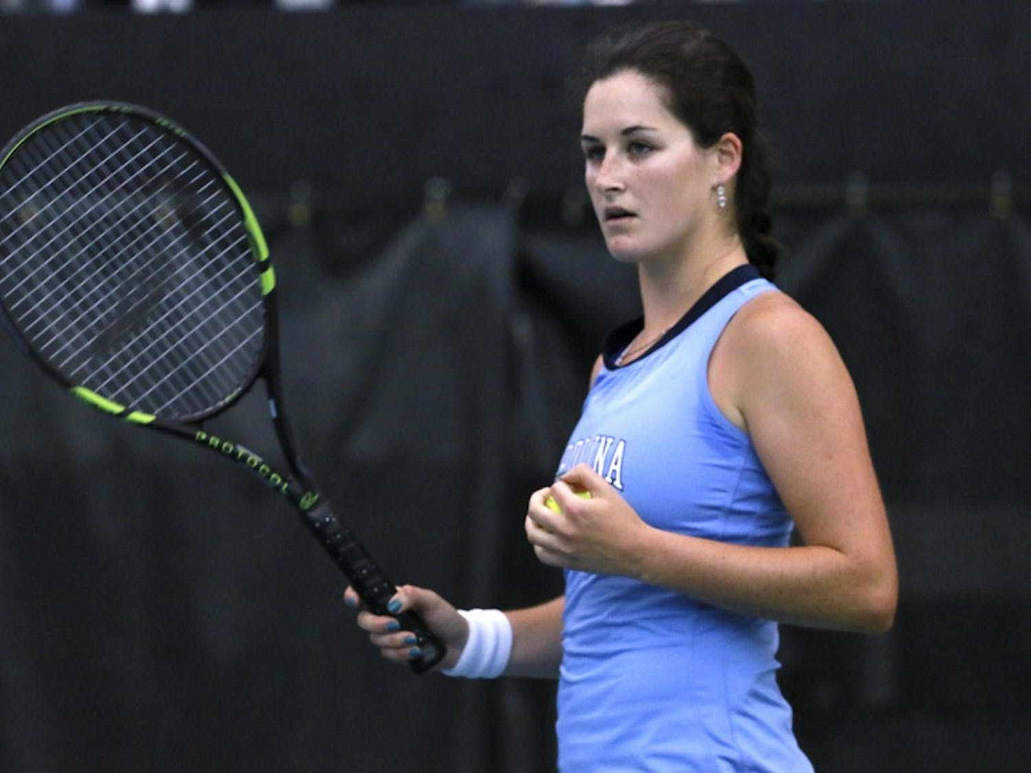 Jamie Loeb prepares to serves in a match against Duke in April. Loeb finished the 2014-15 season by winning an NCAA singles championship.