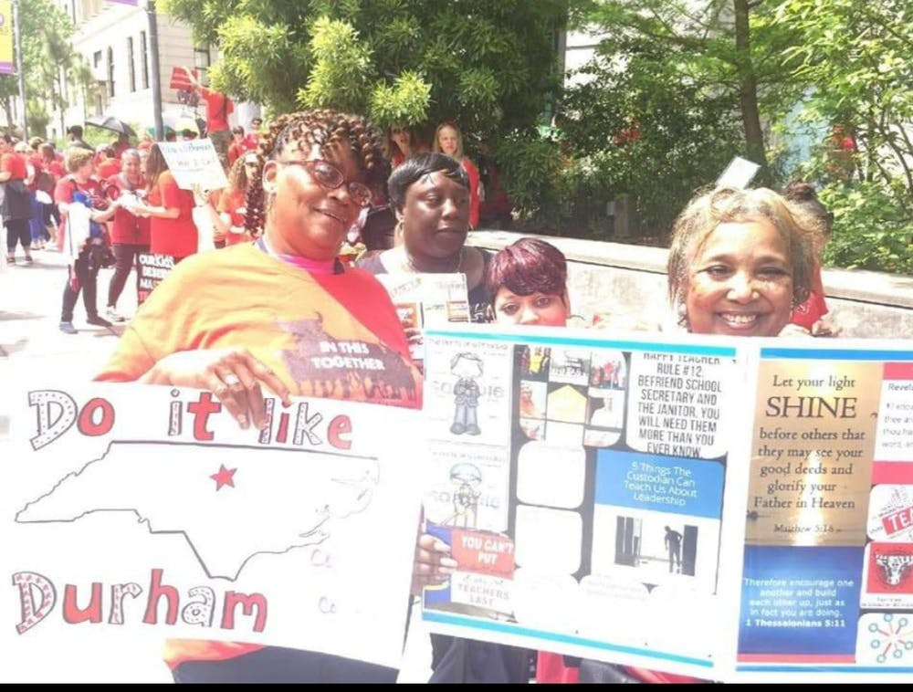 <p>DPS custodians like Deborrah Bailey (right) attend the 2018 NC Public Schools Teacher Rally in Raleigh Day of Advocacy to fight to become in-house district employees rather than contracted. Photo courtesy of Deborrah Bailey.</p>