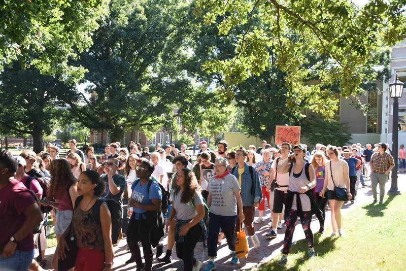 Protestors march from South Building to Silent Sam during the Solidarity Rally and March for the Center for Civil Rights Thursday.