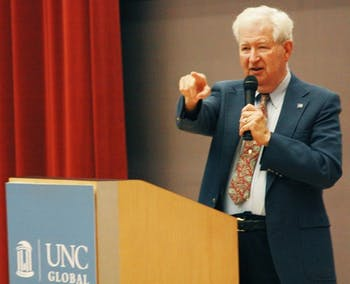 "Charles Green, the co-chair of the West Triangle Chapter of the United Nation introduces Tuesday night's film, ""Fragile States and Global Consequences."" The evening was sponsored in part by the student United Nations Organization at UNC. The event includes a movie showing on the dangers of already unstable nations in jeopardy of failure including Haiti, the Republic of Congo, Bosnia and East Timor."