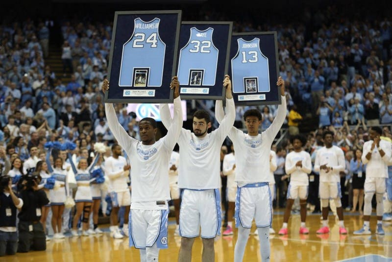UNC seniors Kenny Williams (24), Luke Maye (32) and Cameron Johnson (13) pictured before senior night against Duke at the Smith Center on March 9, 2019.