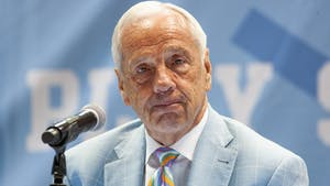 """UNC head coach Roy Williams tears up during his retirement announcement  press conference in the Smith Center on April 1, 2021. """"I no longer feel that I am the right man for the job,"""" said Williams on the decision."""