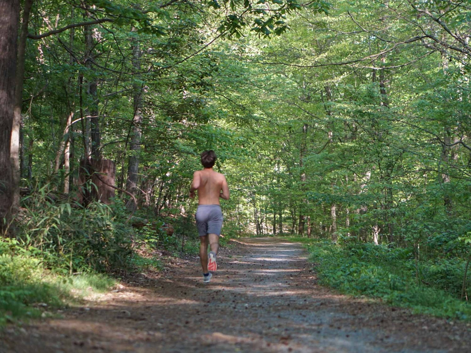 Junior Bridger Scoggins embraces the spring weather by running on trails near campus on April 13, 2021.