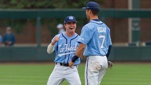 UNC freshman third baseman Patrick Alvarez (8) and UNC senior outfielder Dallas Tessar (7) celebrate at the game against Louisville on Sunday May 16th, 2021 at Boshamer Stadium in Chapel Hill. The Tar Heels won 10-5.