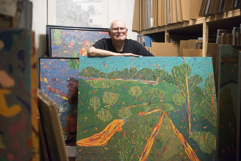 Marvin Saltzman poses with his artwork in his studio, located in Chapel Hill on July 22nd. A small portion of Saltzman's thousands of pieces is currently on display in the Eno Gallery in Hillsboro. 