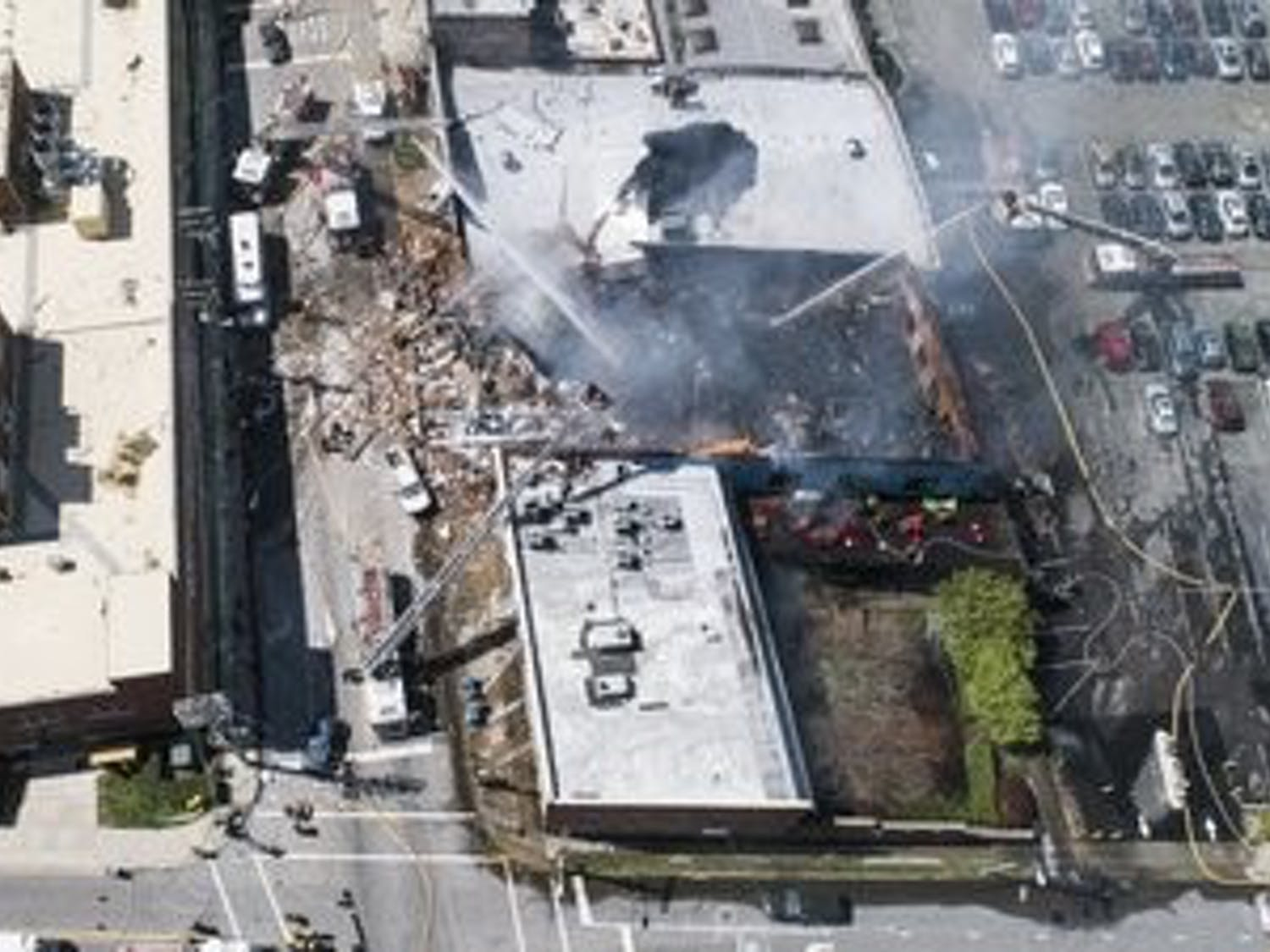 Firefighters actively fight a building fire after a gas leak lead to an explosion and collapse near Brightleaf Square Wednesday April 10, 2019 in Durham, N.C. (Julia Wall/Raleigh News & Observer/TNS)