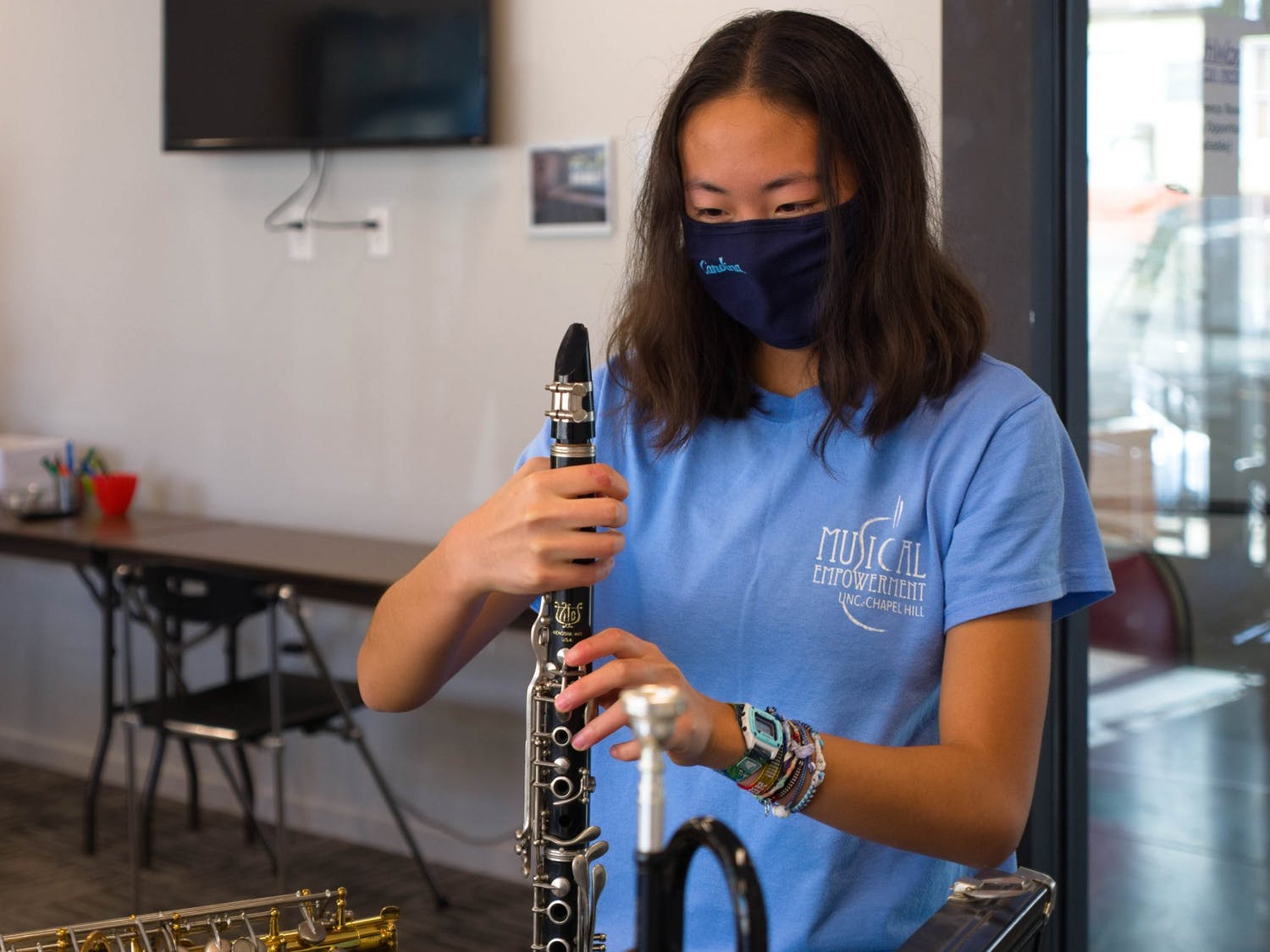 Sophomore Jessica Wu (Biomedical Engineering), a volunteer at Musical Empowerment, assembles a clarinet in the YouthWorx conference room on Wednesday, Dec. 9, 2020.
