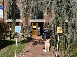 A UNC student stands in line to vote early at Chapel of the Cross on Franklin Street on Thursday, Oct. 15, 2020.