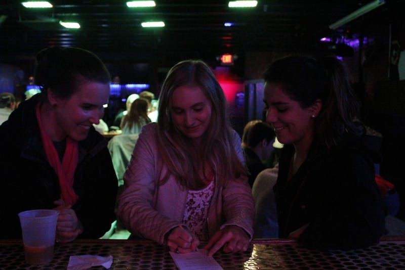 "From left, Paola Vallejos, Erin Brown and Kate Abendroth participate in ""Mean Girls Trivia"" at Country Fried Duck on Monday night."