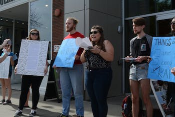 Sammie Espada, a junior women's and gender studies and poll sic double major, reads out grievances addressed to the Equal Opportunity and Compliance Office as protesters watch on in 2017.