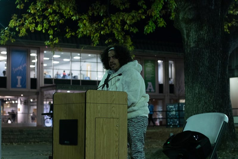 Poet Amir Rabiyah reads poems honoring trans people who have lost their lives in the past year. UNC LGBTQ Center held a candlelight vigil remembering the lives of trans people who died in the past year as part of Transgender Day of Remembrance in the Pit on Wednesday, Nov. 20, 2019.