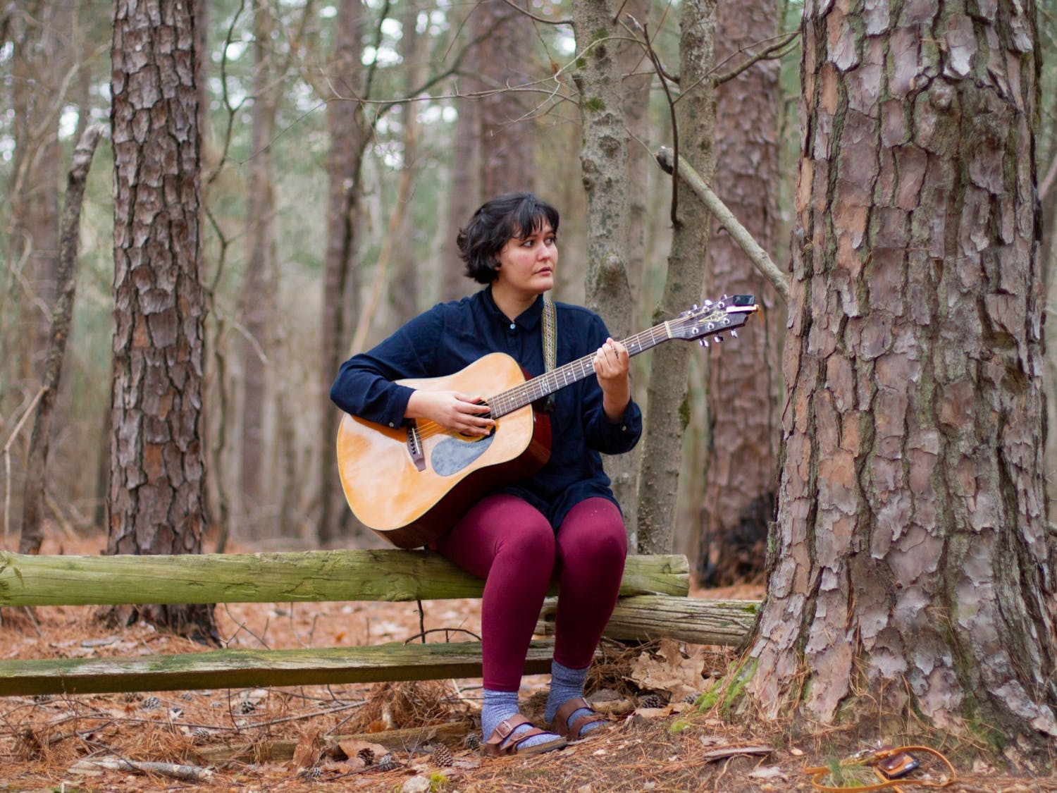 """Remona Jeannine, a Cary-based singer songwriter, plays her song """"Hollow Mouth"""" from her debut album """"Open Space"""" in Cary on Tuesday, Mar. 23, 2021. """"My dad played [the guitar] at home, at church, all over the place,"""" says Jeannine, pictured above with the guitar her father left her when he died."""