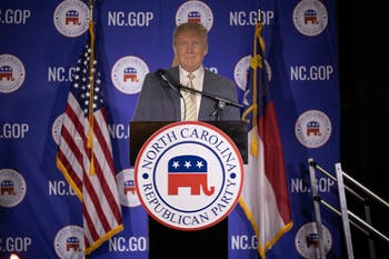 A cardboard cutout of president Donald Trump is propped up on the podium during the NCGOP election night watch party on Tuesday, Nov. 3, 2020.