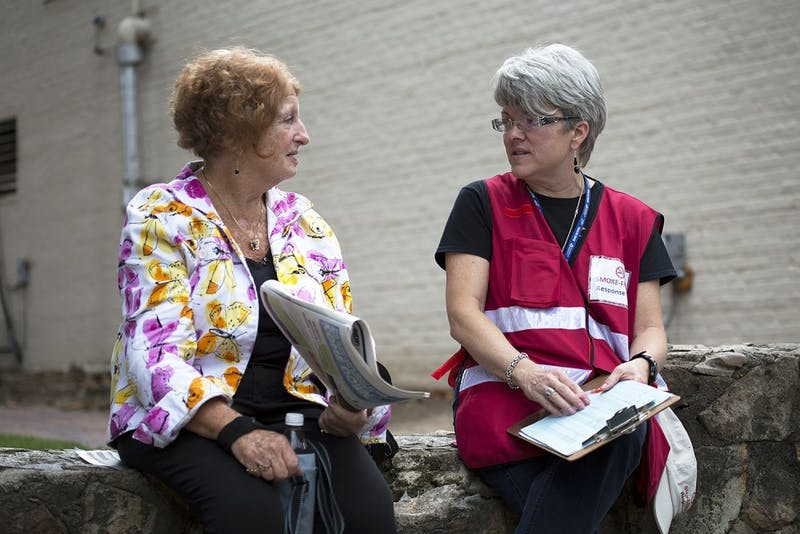 Orange County Health Department worker Donna King speaks with Pittsboro, North Carolina resident Sharon Flicker on Franklin Street about the county's smoking ban. Flicker, a former resident of Queens, New York, supported former New York City Mayor Michael Bloomberg's smoking ordinances and was unaware that Orange County had similar laws.