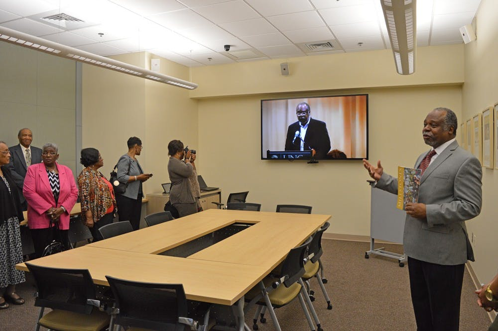 <p>Joseph Jordan, director of the Sonja Haynes Stone Center, welcomes family, friends, and colleagues of the late Curtis Sutton to visit the new Innovation lab that was done in Sutton's honor.</p>