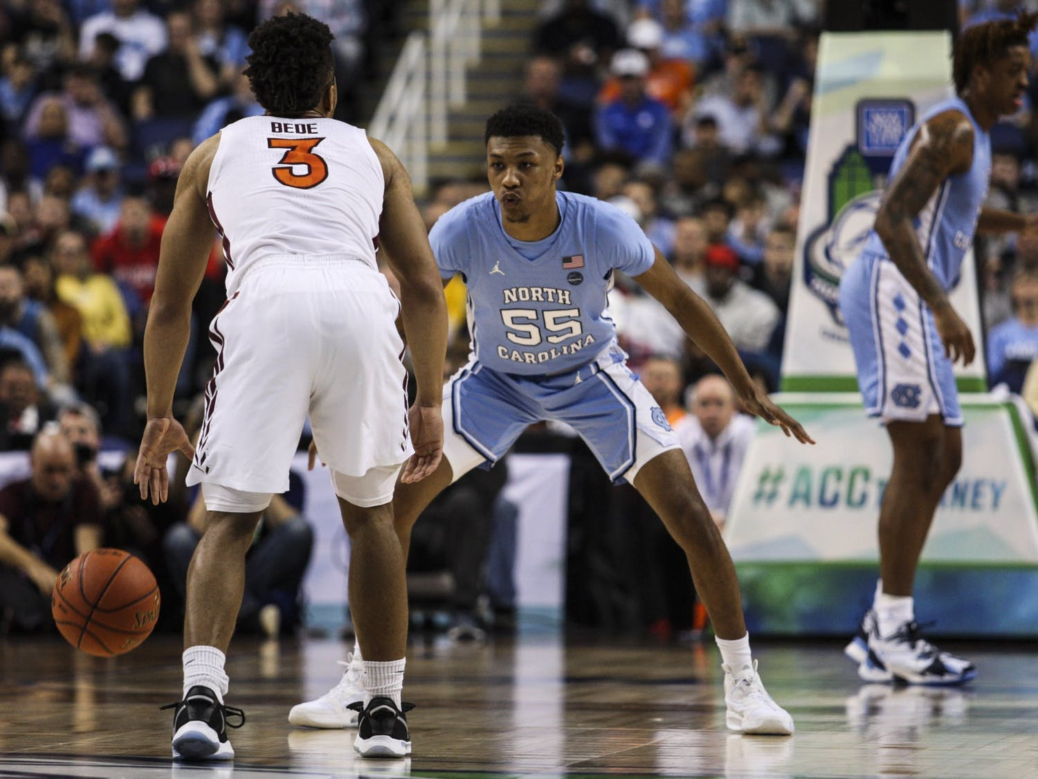 Graduate guard Christian Keeling (55) plays against Virginia Tech's Wabissa Bede (3) during the first round of the ACC tournament in the Greensboro Coliseum Complex on Tuesday, March 10, 2020.