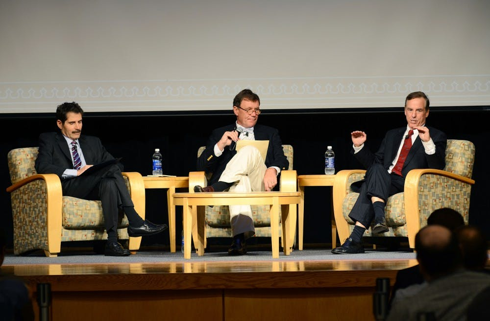 """<p>John Stossel, left, and Howard Dean, right, participate in a debate presented by <span class=""""caps"""">UNC</span> College Republicans.</p>"""