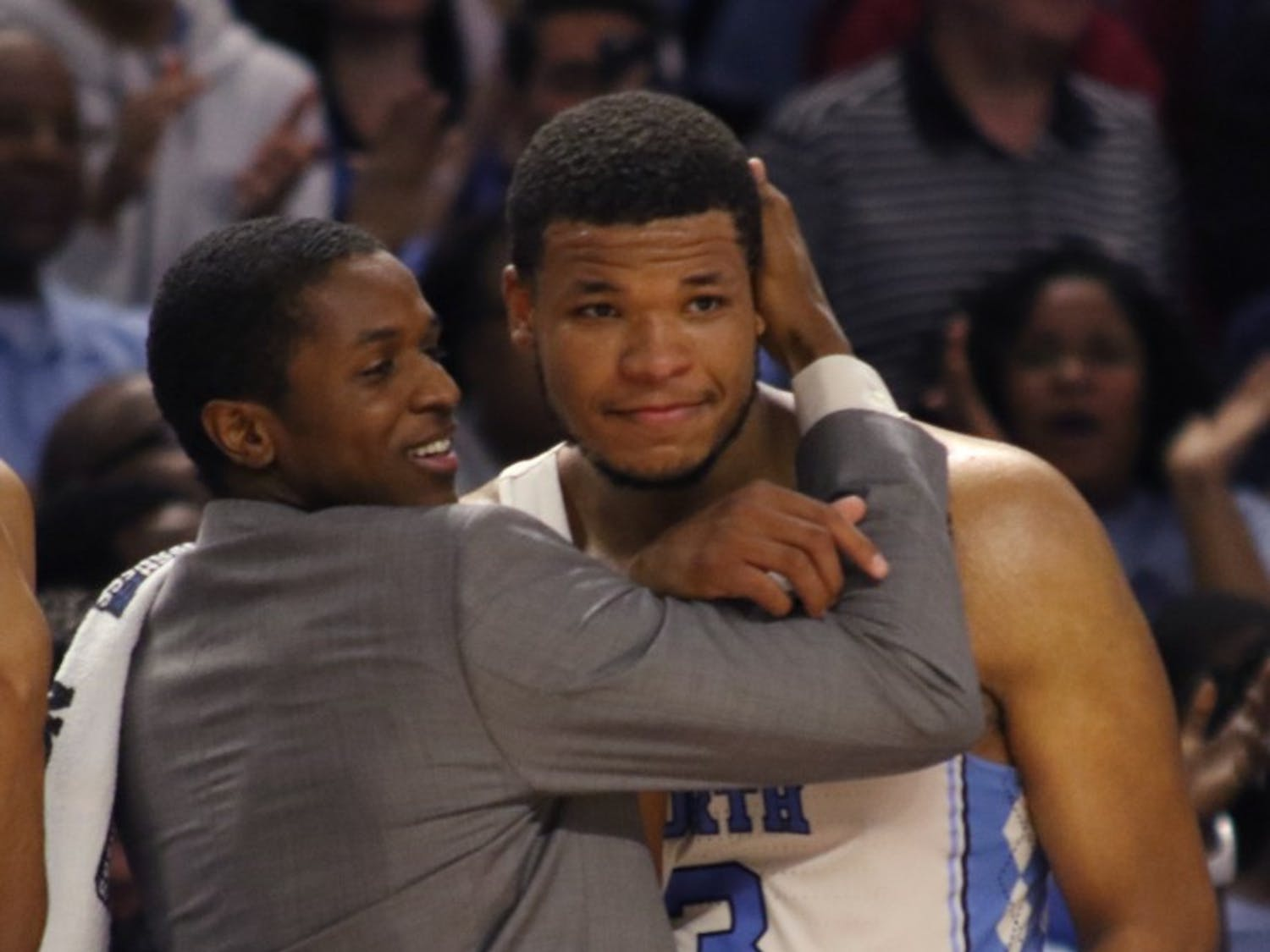 North Carolina forward Kennedy Meeks (3) is embraced by guard Kenny Williams on the bench at the end of the team's victory of Arkansas in the second round of the NCAA Tournament in Greenville on Sunday.