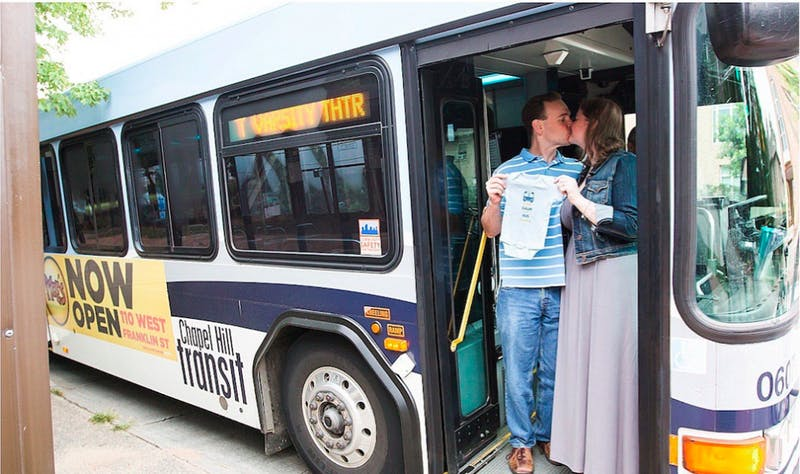 David Donovan and Ashley Donovan have part of their maternity photo shoot, in 2016, on a Chapel Hill bus where they first met. Photo courtesy of David Donovan.