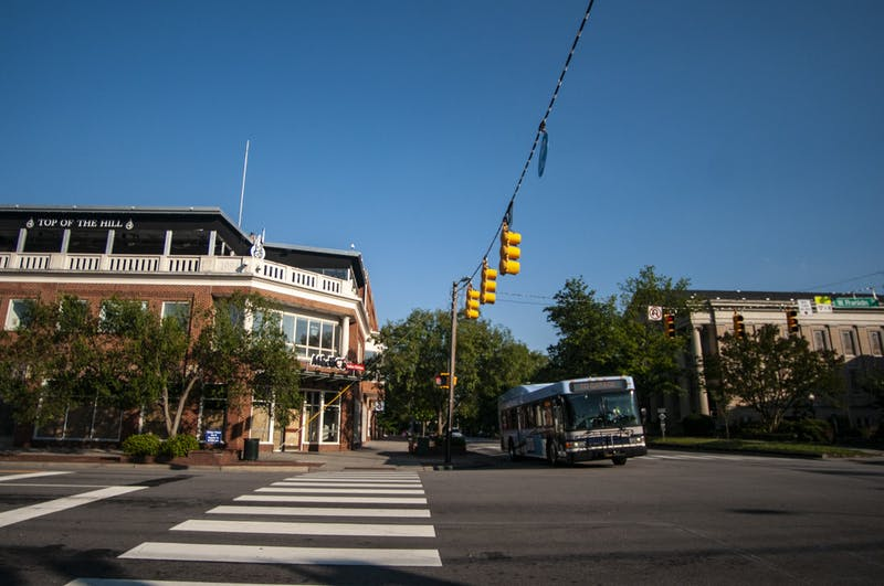 A Chapel Hill Transit bus approaches Franklin Street on Wednesday, June 24, 2020 after the new safety regulations due to COVID-19 had been implemented.