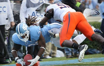 UNC's Ryan Houston completes a one-yard run during the 2nd quarter to put the Tar Heels up 14-3 in the game on Saturday. UNC defeated Virginia 28-17.